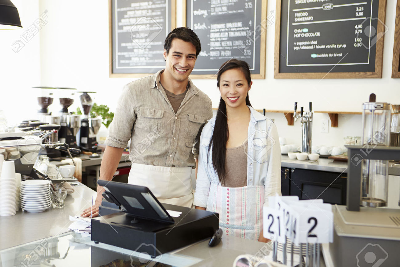 31020676-male-and-female-staff-in-coffee-shop-stock-photo-shop-business